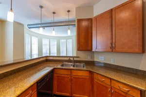 Two Bedroom Apartments for Rent in Houston, TX - Apartment Kitchen with Breakfast Bar & Living Room View